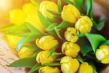 bouquet of yellow tulips close up. greeting card