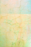 Wall with cracked pale yellow and green paint. Bright background with vignette. Texture of old cover with cracks. - 196929393