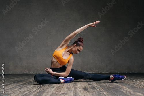 Obraz na płótnie Young beautiful athlete is posing in studio