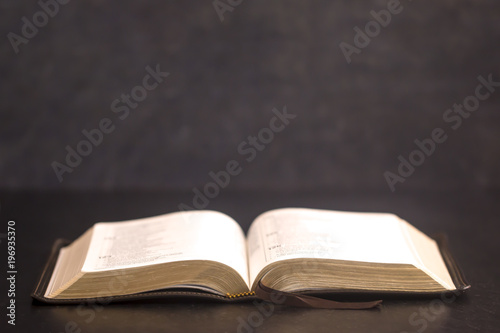 Open Bible on a Slate Tabletop with Customizable Space to Add Text