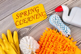 House cleaning items on wooden background. Set of equipment for spring house cleaning. Cleaning service concept. - 196935933