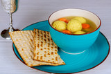 Delicious Matzoh ball soup with Pesach Passover symbols