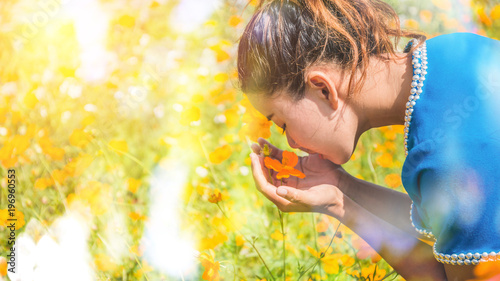 Fotobehang Zwavel geel Asian women travel relax in the holiday. Flower pasture on the Mountain in summer. Thailand