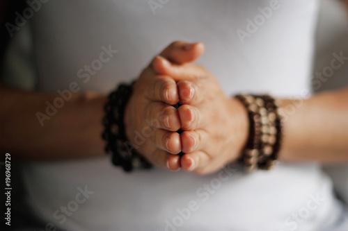 Woman hand yoga pose. Practicing meditation and praying indoors.