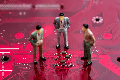 small toys people are on the red motherboard .