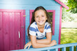 portrait of a beautiful child girl in wood hut garden