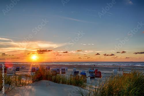 canvas print picture Sonnenuntergang am Strand auf der ostfriesischen Nordseeinsel Juist in Deutschland, Europa.