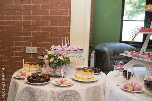 Fotobehang Macarons Candy bar. A lot of sweets at the wedding banquet.