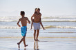 Father With Children Having Fun On Summer Beach Vacation