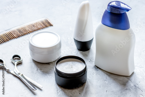 mens cosmetics for hair in bottle at bathroom