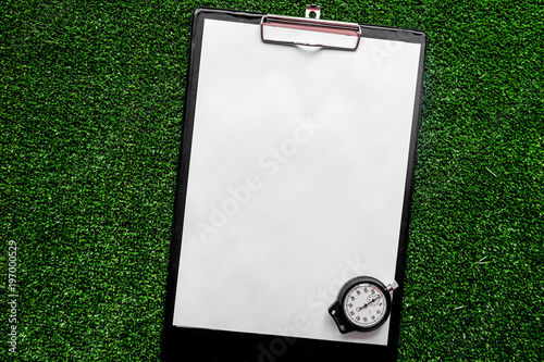 concept refereeing sport on green background top view mock up