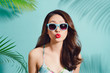 Summer fashion portrait of beautiful elegant asian woman posing in summer outfit