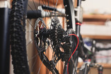 selective focus of bicycle wheel with chain in workshop