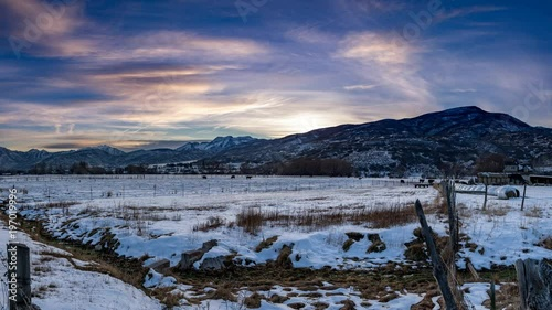Sticker Cinemagraph of a cold winter night in the mountain valley with the clouds in time lpase motion in an endless and seemless loop
