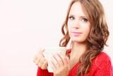 Autumn woman holds mug with coffee warm beverage - 197025528