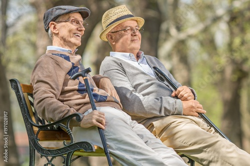 Seniors relaxing on a bench