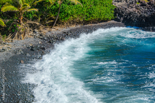 Waves or Turquoise Ocean Water Crashing into the Beaches and cliffs in Maui Road to Hana  - 197042713