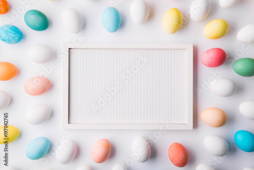 Eggs flat lay on a white background. Easter and spring composition.
