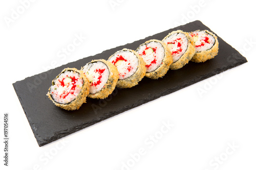 In de dag Sushi bar Sushi Roll with cream cheese above and Fresh fish and Avocado on a slate slab on white background
