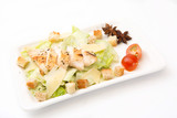 Homemade Vegetable salad with chicken and cheese on white rectangular plate on white background - 197054739