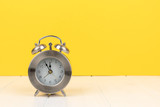 alarm clock with yellow background