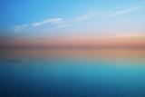 Delicious delicate sunset over a calm sea - 197064189