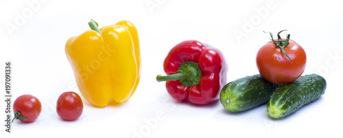 Foto op Aluminium Verse groenten Red pepper with yellow pepper and tomatoes on a white background.
