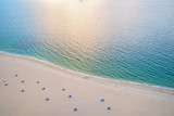 Sea beach, aerial view. Sand beach and blue sea water seen from above. Summer vacation concept. Wanderlust, travel, trip. Adventure, discovery, journey