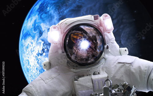 Asrtonaut in deep space near earthlike planet . Elements of this image furnished by NASA - 197099550