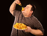 Diet failure of fat man eating fast food. Overweight person who spoiled healthy food by eating french fries. Junk meal leads to obesity. Person is happy that he defeated anorexia. - 197106710