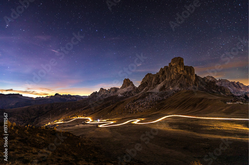 Foto op Aluminium Chocoladebruin Car travels through mountains at night