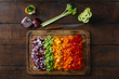 Chopped vegetables arranged on cutting board on wooden table, top view - 197138352