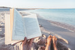 Reading book near the sea