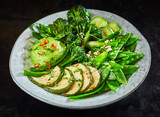 Tasty green vegetable Buddha bowl with avocado dip