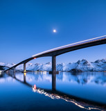 Bridge and reflection on the water surface. Natural landscape in the Norway