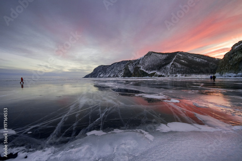Fotobehang Lavendel Lake Baikal at sunset, everything is covered with ice and snow, thick clear blue ice. Lake Baikal in the rays of the setting sun. Amazing place, UNESCO world heritage