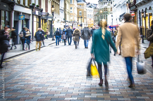 Motion blurred couple on shopping street - 197165923