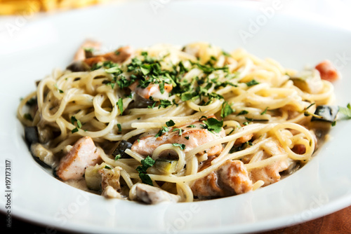 Fototapeta Seafood tagliatelle cream sauce and vegetables