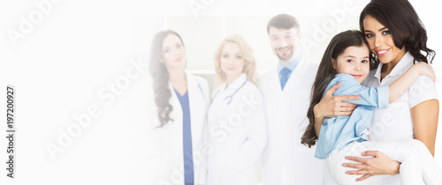 Mother, daughter and team of doctors