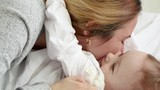 Slow motion of mother and baby daughter intimate moment