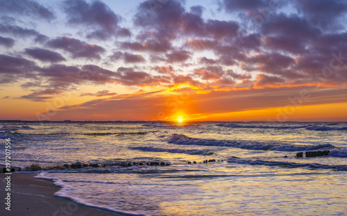 Foto op Canvas Zee zonsondergang dramatic, red sunset over the sea, Baltic Sea, Poland