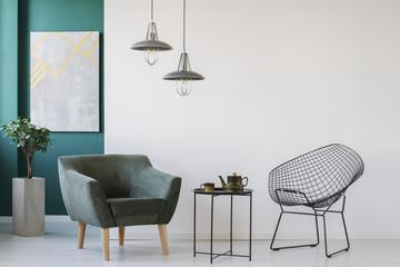 Coffee table between armchairs