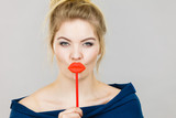 Funny woman holding big red lips on stick - 197221309