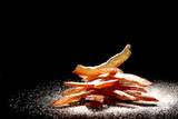 Tasty candied orange peel covered by powdered sugar - macro foto,with place for a text.