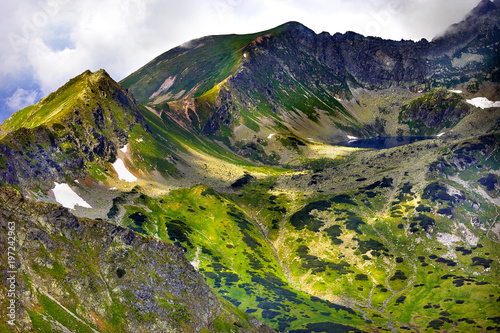 Poland, Tatra Mountains, Zakopane - Dolina Pieciu Stawow Valley, Zadni Staw Pond, Gladki Wierch, Walentkowy Wierch peaks and Walentkowa Pass with High Tatra mountain range panorama in background