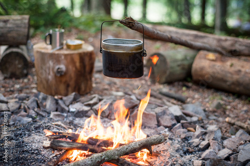 Camping cooking on a campfire outdoor, tourist kettle.