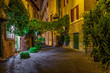 Night view of old cozy street in Trastevere in Rome, Italy