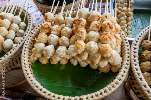 Close up of meat brochette over a straw tray at food street market at Khao San Road, this road is popular among backpacker because budget accommodation and food - 197276120