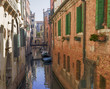 view on a colorful, narrow and gorgeous canal of Venice,Italy