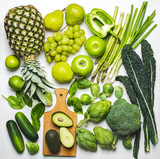 Green vegetables and fruits on a white background. Fresh organic produce. Healthy food. Top view